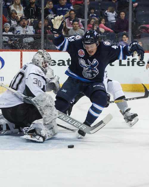 MIKE DEAL / WINNIPEG FREE PRESS Manitoba Moose' Brendan Lemieux (48) tries to avoid hitting the hitting San Antonio Rampage' goaltender Spencer Martin (30) while he is checked from behind by Rampage' Mason Geertsen (2) in AHL season action at the MTS Centre Sunday afternoon.  170226 - Sunday, February 26, 2017.