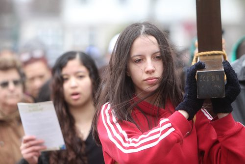 RUTH BONNEVILLE /  WINNIPEG FREE PRESS  Jean Thomson, a grade nine student at St. Mary's Academy, helps carry the cross through streets surrounding her school during the 30th Annual Public Way of the Cross on the morning of Good Friday. Bishops, teachers and students took turns helping to carry the cross through the streets of Crescentwood led by singers and followed by a few thousand people.  The event was co-sponsored by St. Mary's Academy and the Archdiocese of Winnipeg Office of Youth and Young Adult Ministry.  April 14, 2017