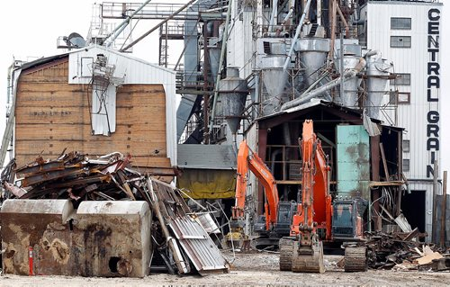 PHIL HOSSACK / WINNIPEG FREE PRESS  -  Heavy equipment idles in front of Central Grain at Provencer and Archibald Monday, waiting to resume demolition of the grain handling facilit. See story about demolition causing a rat problem in the area.   -  April 17,  2017