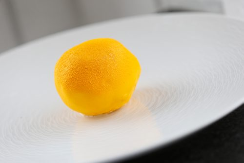 "JOHN WOODS / WINNIPEG FREE PRESS Chef Sophon Chhin's creation ""Citron"" - Chocolate shell. lemon ganache, lemon marmalade, mint, candied lemon peel is on the menu at Baon's Manila Nights event, Midnight In Paris, the first in their new dessert pop-up series at Sugar Blooms and Cakes Cafe, Sunday, April 23, 2017."