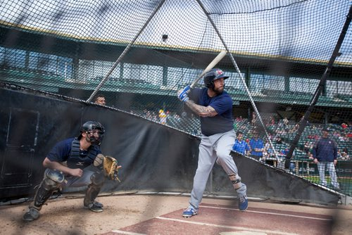 First baseman David Bergin (#13) at bat during the Winnipeg Goldeyes Open House at Shaw Park. Goldeyes' manager Rick Fortney can be seen in the background at right. Saturday, May 6, 2017. Copyright Jessica Finn for the Winnipeg Free Press.