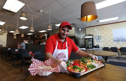 RUTH BONNEVILLE /  WINNIPEG FREE PRESS  Restaurant Review:  Les Saj, Middle Eastern on St. James. Part owner Adam Tayfour, makes  saj bread and Mezza platter. Saj bread is baked on a big heated dome   and is super thin.  Mezza platter is a appetizer platter.   They can include homemade humus, falafel balls as well as dips, fries and veggies. See Alison Gilmor review.   June 02, 2017
