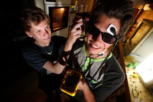 JOHN WOODS / WINNIPEG FREE PRESS Grade twelve students Matthew Hewlett (L) and Caleb Turon are photograph with their invention at Assent Works Tuesday, June 26, 2017. The friends have developed a device which uses Transcranial Direct Current Stimulation (tDCS) to stimulate different parts of the brain and assist those with acquired blindness with navigation.