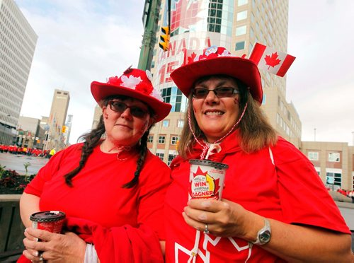 BORIS MINKEVICH / WINNIPEG FREE PRESS 3,600 proud Winnipeggers joined together bright and early at Portage & Main to create a human flag celebrating Canada Day. From left, Claudette Delorme and Lorraine Kahler at the event. July 1, 2017