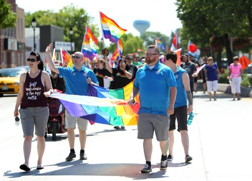 RUTH BONNEVILLE / WINNIPEG FREE PRESS  Michelle McHale and Chris Plett  organizers for Steinbach Pride walk at the front of the line with hundreds  of parade goers following along them down Main Street in Steinbach in the 2nd annual Steinbach Pride Parade Saturday.   July 15, 2017