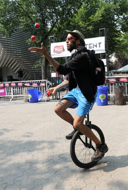 RUTH BONNEVILLE / WINNIPEG FREE PRESS  Daniel Both juggles while riding a unicycle for fun while at the 30th annual Fringe Festival in Market Square Thursday afternoon.   Standup photo    July 20, 2017