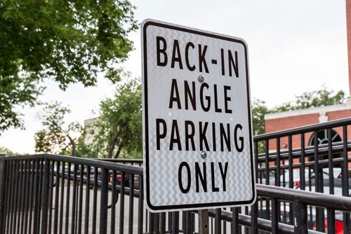 JUSTIN SAMANSKI-LANGILLE / WINNIPEG FREE PRESS A sign explains the new parking procedure for the new angled parking spots on Bannatyne Ave. The change from parallel to angled street parking will increase the total parking spots in the area by 10. 170721 - Friday, July 21, 2017.