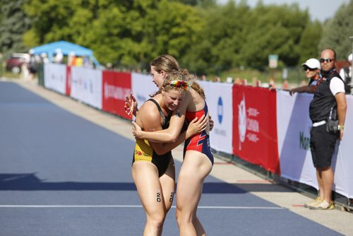 JUSTIN SAMANSKI-LANGILLE / WINNIPEG FREE PRESS Manitoba's Kyla Roy embraces B.C's Hannah Henry at the finish line during Monday's women's triathlon at Birds Hill Park. B.C. athlete Desirae Ridenour finished first, teammate Henry finished second and Roy finished third. 170731 - Monday, July 31, 2017.