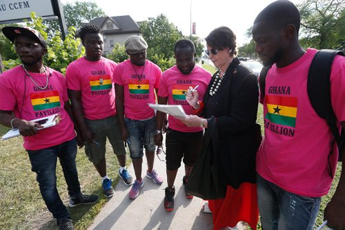 JOHN WOODS / WINNIPEG FREE PRESS Senator and Global College Professor Marilou McPhedran signs a petition outside the the Caribbean Pavilion calling on the Ghanaian government to change their ant-LGBTQ policies Tuesday, August 8, 2017. McPhedran brings her Human Rights UniverCity students on a bus to the Caribbean Pavilionand and will discuss in their classroom the Ghanaian petitioners who have been gathered outside the pavilion collecting signatures calling on the Ghanaian government to change their ant-LGBTQ policies.