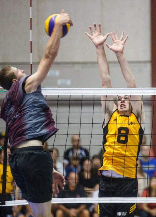 MIKE DEAL / WINNIPEG FREE PRESS Team Manitoba mens volleyball team plays against Team Newfoundland Wednesday morning at Investors Group Athletics Centre. Manitoba' Dylan Sutherland (8) goes to block Newfoundlands' Nick Taylor (5) during game play. 170809 - Wednesday, August 09, 2017.