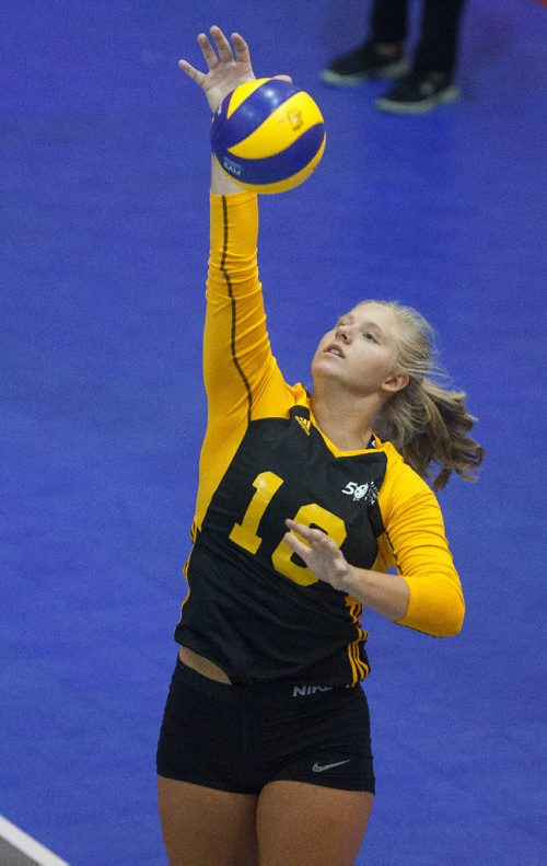 MIKE DEAL / WINNIPEG FREE PRESS Team Manitoba women's volleyball team plays against Team PEI Wednesday afternoon at Investors Group Athletics Centre. Manitoba' Ashleigh Laube (18) spikes the ball during game action. 170809 - Wednesday, August 09, 2017.