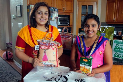 BORIS MINKEVICH / WINNIPEG FREE PRESS From left, Sisters Simryn Singh,15, and Jasmyn Singh,11, The two sisters tarted a local charity organization to feed the homeless. They'll be serving between 600 to 800 meals at a charity event tomorrow. August 11, 2017