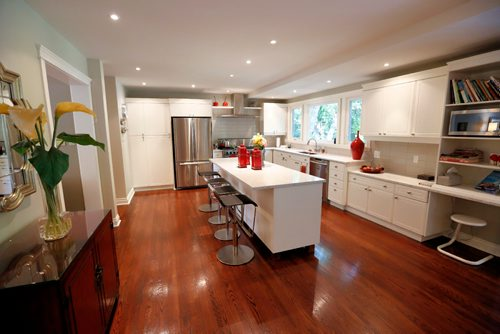 JUSTIN SAMANSKI-LANGILLE / WINNIPEG FREE PRESS The large kitchen of 59 Salme features all stainless appliances, large windows and a spacious island with access to the family room, laundry room, dining room and patio. 170822 - Tuesday, August 22, 2017.