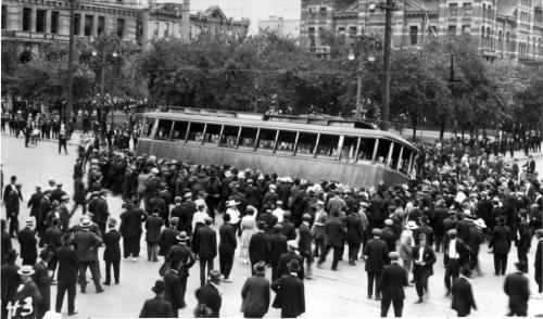 1919 Winnipeg general strike street car streetcar overturned on Main Street in front of the old City Hall building (R)