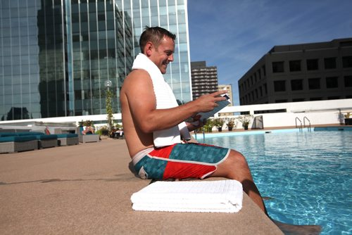 RUTH BONNEVILLE / WINNIPEG FREE PRESS  Standup Feature:   John Millner enjoys some down time in the warm sun at the Delta Marriott Hotels Blu Pool and Terrace, Winnipeg's only rooftop outdoor pool, while in Winnipeg on a business trip Monday.     SEPT 11, 2017