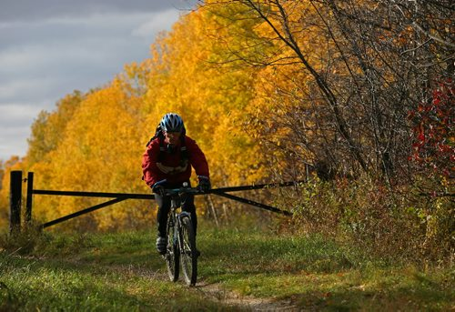 Brandon Sun  10102008 A cyclist makes his way along a path at the Brandon Hills recreational area south of Brandon, Man. on a colourful fall Friday, October 10, 2008. (Tim Smith/Brandon Sun)