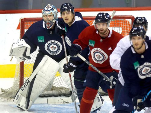 WAYNE GLOWACKI / WINNIPEG FREE PRESS  At left, goaltender Steve Mason watches puck with lot of distraction in front of him at Winnipeg Jets practice at the Bell MTS Place Tuesday. Jason Bell story¤ Oct.3 2017