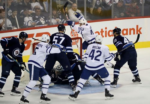 TREVOR HAGAN / WINNIPEG FREE PRESS Toronto Maple Leafs' Nazem Kadri (43), top, celebrates as he scores on Winnipeg Jets' goaltender Steve Mason (35) during first period NHL hockey action on the opening night, Wednesday, October 4, 2017.