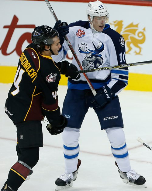 JOHN WOODS / WINNIPEG FREE PRESS Manitoba Moose Buddy Robinson (10) and Cleveland Monsters' Blake Siebenaler (4) collide during second period AHL action in Winnipeg on Sunday, October 15, 2017.