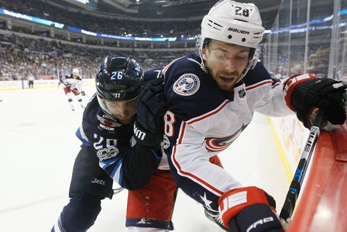 JOHN WOODS / WINNIPEG FREE PRESS Winnipeg Jets' Blake Wheeler (26) checks Columbus Blue Jackets' Oliver Bjorkstrand (28) during second period NHL action in Winnipeg on Tuesday, October 17, 2017.
