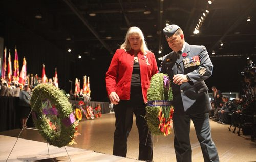 RUTH BONNEVILLE / WINNIPEG FREE PRESS  Wendy Hayward, mother of Corporal James Arnal who was killed while serving Canada in Afghanistan, lays wreath for memorial cross mother during the annual Winnipeg Remembrance Day Service, at RBC Convention Centre Saturday.    See Ryan Thorpe story.   Nov 11, 2017
