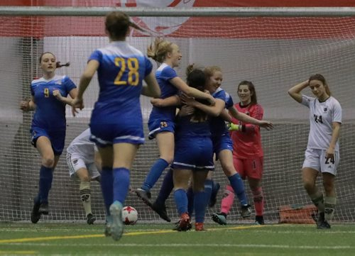 COLIN CORNEAU / WINNIPEG FREE PRESS University of Manitoba Bisons' Hayley Ward walks past University of Victoria Vikes' Victoria Wulff (centre) is hugged by teammates Elise Butler (left) and Emily Lieuwen after their team scored its second goal during championship match play in the 2017 U Sports Women's Soccer National Championship. November 12, 2017