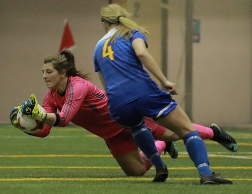 COLIN CORNEAU / WINNIPEG FREE PRESS University of Manitoba Bisons' goalie Justina Jarmoszko makes a save with University of Victoria Vikes' forward Kiara Kilbey close by during championship match play in the 2017 U Sports Women's Soccer National Championship. November 12, 2017