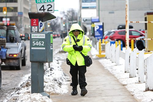 RUTH BONNEVILLE / WINNIPEG FREE PRESS  Visuals for story on parking rates going up in Winnipeg. Photo of parking patrol on Donald issueing  a ticket.   See parking rate hike story.   Nov 23, 2017