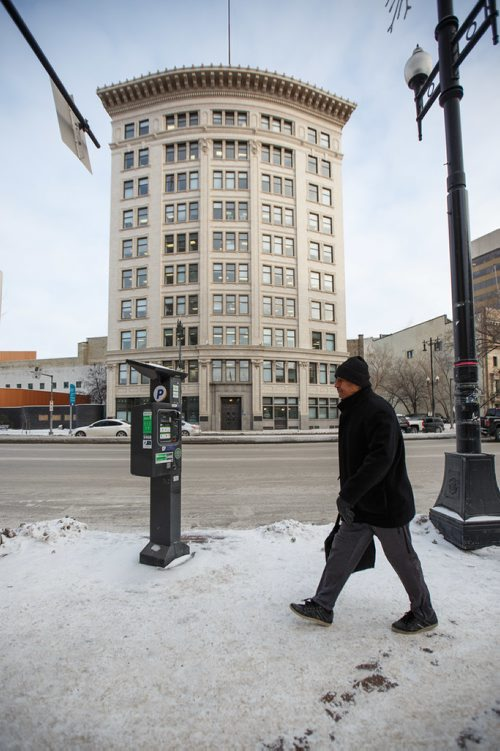 MIKE DEAL / WINNIPEG FREE PRESS Some parking meters in the Exchange area have new stickers on them explaining the hourly rates. The two free hours on Saturday stickers are still there as well. 180102 - Tuesday, January 02, 2018.