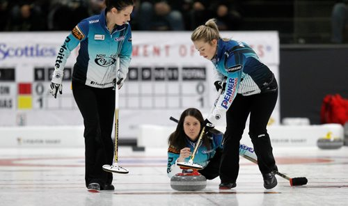 PHIL HOSSACK / Winnipeg Free Press - SCOTTIES - Skip Kerri  Einarson delivers between sweepers Liz Fyfe (left) and Kristin MacCuish Wednesday.  January 10, 2018