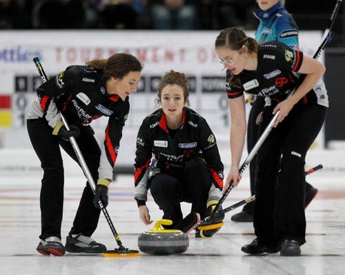PHIL HOSSACK / Winnipeg Free Press - SCOTTIES - Skip Mackenzie Zacharias delivers between sweepers Emily Zacharias (left) and Ashley Groff Wednesday.  January 10, 2018