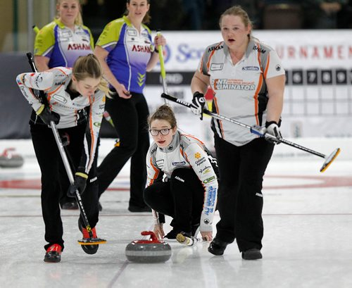PHIL HOSSACK / Winnipeg Free Press - SCOTTIES - Skip Rebecca Lamb watches her rock as sweepers Brooklyn Meiklejohn (left) and Jenessa Rutter take over Wednesday in Killarney.  January 10, 2018