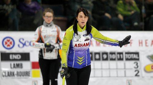 PHIL HOSSACK / Winnipeg Free Press - SCOTTIES - Skip Jennifer Clark- Rouire signals her team as Rebecca Lamb watches Wednesday in Killarney.  January 10, 2018