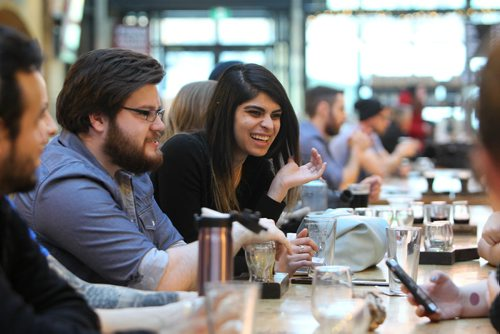 RUTH BONNEVILLE / WINNIPEG FREE PRESS  Biz story on Forks developments. Yashila Ramdoyal (centre girl, long brown hair) shares some laughs with friends at one of the long table at the Forks Common Friday afternoon.  Jan 12, 2018