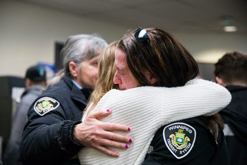 MIKAELA MACKENZIE / WINNIPEG FREE PRESS Crystal Hanley (right) hugs Penny Teron at a memorial for Irvine Jubal Fraser, an operator killed one year ago, held by the he Amalgamated Transit Union in Winnipeg, Manitoba on Wednesday, Feb. 14, 2018.  180214 - Wednesday, February 14, 2018.