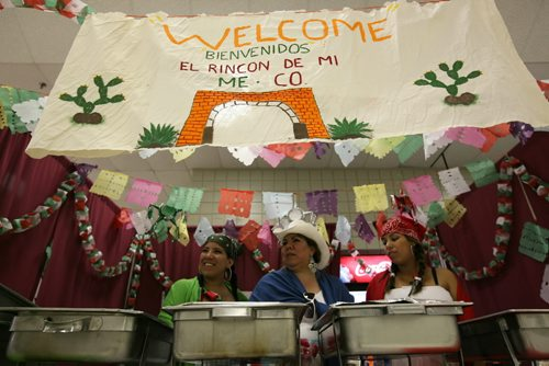 Brandon Sun From left: Jennyfer Zavala, Marla Zavala and Perla Yessinia Mendoza ready the Mexican booth at the Multicultural Marketplace in the UCT Pavilion, Wednesday afternoon during the Summer Fair. (Colin Corneau/Brandon Sun)