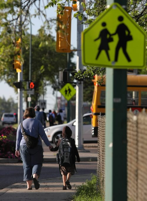 Brandon Sun A mother walks her son to school along 18th Street for the first day back to school at Earl Oxford on Wednesday morning. (Bruce Bumstead/Brandon Sun)