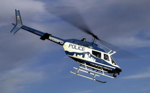 A Colorado Springs Police Department helicopter patrols over Colorado Springs on Thursday October 18, 2001.  Jay Janner/The Gazette - for winnipeg free press