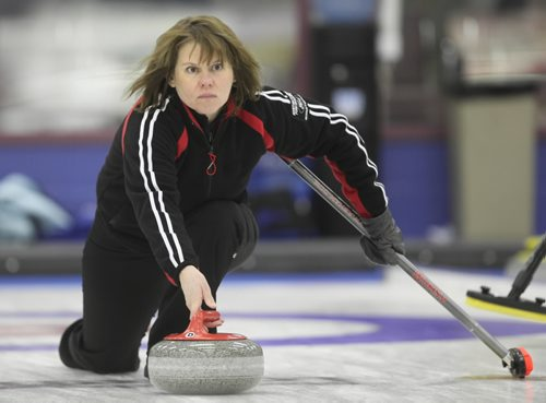 Brandon Sun 17012010 Skip Deb Collyer throws a rock during her rinks A-final match against Lois Fowler's rink in the 74th Annual Brandon Ladies Bonspiel at the Brandon Curling Club on Sunday afternoon. (Tim Smith/Brandon Sun)