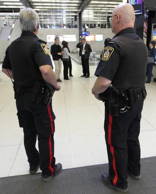 JOE.BRYKSA@FREEPRESS.MB.Ca  Local- (See Geoff's story)- Winnipeg Police Services officers Const Ed Schellberg, left, and Const Morris Skrembicki keep a close eye at James A Richardson International airport on Thursday afternoon Apr 15, 2009- JOE BRYKSA/WINNIPEG FREE PRESS