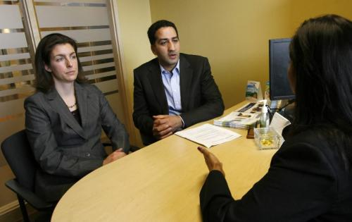 MIKE.DEAL@FREEPRESS.MB.CA 100505 - Wednesday, May 5th, 2010 Charaf Charaoui and his wife Maude Plourde talk to their financial advisor, Zaila Kahn at the Assiniboine Credit Union where the first Islamic Mortgage in Canada. See Geoff Kirbyson story. MIKE DEAL / WINNIPEG FREE PRESS