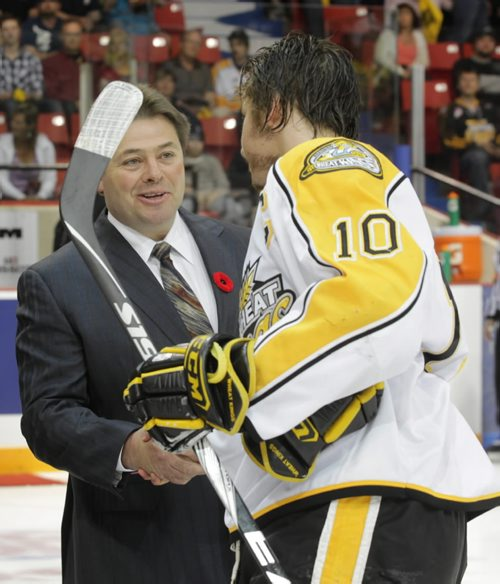Brandon Sun Brad McCrimmon shakes hands with Brayden Schenn following the ceremonial face-off during Friday night's MasterCard Memorial Cup semi-final game at Westman Place. (Bruce Bumstead/Brandon Sun)