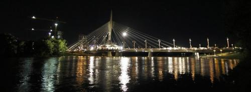 "PHIL.HOSSACK@FREEPRESS.MB.CA 100527-Winnipeg Free Press THe Provencher Foot Bridge is lit up ""Hollywood Style"" Wednesday evening as a scene from a movie starring Milla Jovovich uses the structure for a scene.........See Wayne Boyce's fantasy......"