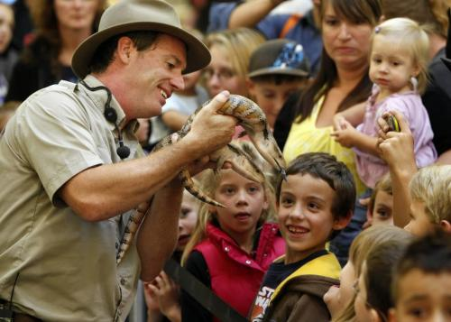 """BORIS.MINKEVICH@FREEPRESS.MB.CA  100909 BORIS MINKEVICH / WINNIPEG FREE PRESS Safari Jeff (Jeff McKay) puts on a traveleing reptile show called """"Living Wild"""" at Kildonan Place Shopping Centre. The show runs until Sept 12th. Here the kids get to get a close look at Skeeter and Scooter, a pair of blue tounge skinks."""
