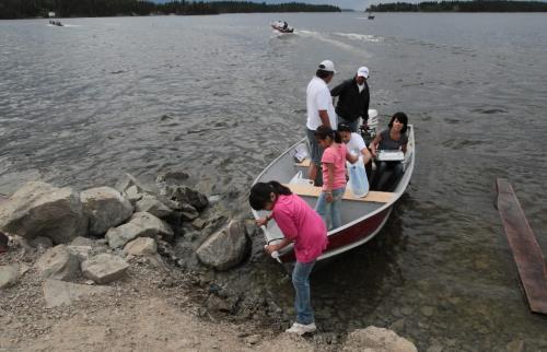JOE.BRYKSA@FREEPRESS.MB.CA NO RUNNING WATER FEATURE-(See Helen's story)  - - Boats run non-stop on Island Lake. These people arrive with supplies at Garden Hill First Nation- July 2010, - JOE BRYKSA/WINNIPEG FREE PRESS