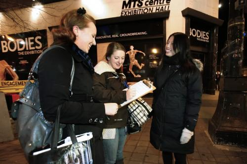 November 12, 2010 - 101112  -  Ashleigh Meyer (R) and Paulina Parada sign a petition for Judith Cheung outside Bodies: The Exhibition exhibit Friday November 12, 2010. The petition is close down the controversial exhibit amidst ethical concerns.  John Woods / Winnipeg Free Press