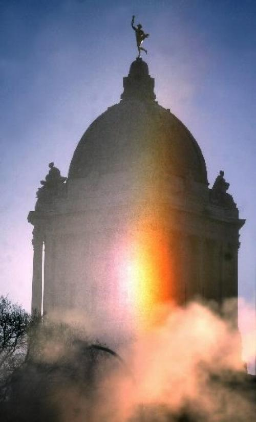 Marc Gallant/Winnipeg Free Press. Local- Cold weather standup. SUNDOG. Rays from a  bright sundog appear in the sky with Manitoba Legislature in background. Photographed at 10:00 am. December 22, 2004.