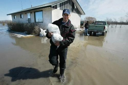Marc Gallant/Winnipeg Free Press. Local- Rising Water. Ice from Red River jammed north of Selkirk, backing water onto river homes. St. Andrews Road, north of Selkirk. Homeowner Randy Hallson saw higher waters in 1996. (Jason Bell story). April 3, 2004.