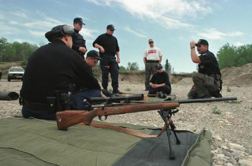 May 26, 1999--Rossburn, MB--RCMP constables listen during sniper drill at a gravel pit near their camp. RCMP from around the province are currently on two day exercises near Rossburn. Photo by Fred Greenslade