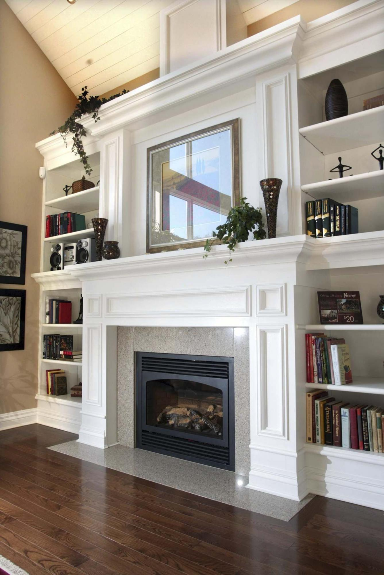 <p>BRUNO SCHLUMBERGER / OTTAWA CITIZEN FILES</p><p>A stunning focal wall with a fireplace and shelves painted a crisp white creates impressive results in this living room.</p>